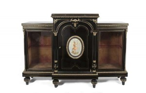 A 19th century ebony breakfront side cabinet (1,500-2,500).