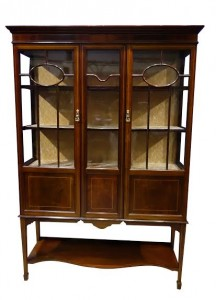 An Edwardian mahogany and satinwood inlaid display cabinet at Hegarty's (2,500-3,500).