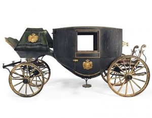 A ROYAL SAXON BRASS-MOUNTED PARCEL-GILT AND BLACK-PAINTED TOWN COACH BY CARL HEINRICH GLÄSER (1831-1903), DRESDEN, CIRCA 1870 (£20,000-40,000). Courtesy Christie's Images Ltd., 2015.