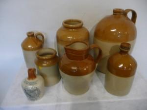 Seven earthenware jars (60-100).