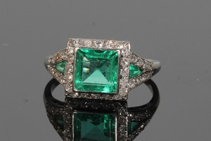 An antique emerald and diamond cluster ring (4,500-5,000).