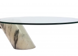 An elliptical coffee table by Cini Boeri (600-900).