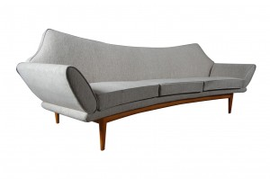 A freestanding three seater sofa with oak frame at Omnipod.