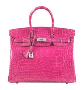 An Exceptional Shiny Fuchsia Porosus Crocodile Diamond Birkin 35 with 18K White Gold & Diamond Hardware, Hermès, 2014 made US$222,912, a world record for a handbag.