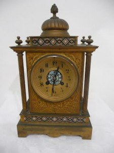 Antique french gilded and brass mantel clock with cloisonne panels. Circa 1900. (100-200).