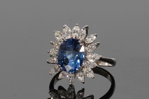 A diamond and sapphire cluster ring (5,000-6,000).