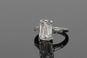 An emerald cut diamond solitaire ring 5.40 carats (60,000-70,000).