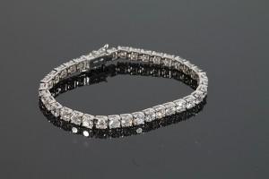 A diamond line bracelet (14,000-16,000).