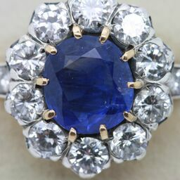 A c1890 Burmese sapphire and diamond cluster ring at Weldons (18,500).