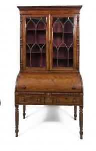 A GEORGE IV INLAID MAHOGANY CYLINDER BUREAU BOOKCASE (2,000-3,000).