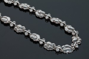 A silver necklace by Georg Jensen (signed) (1,100-1,300).