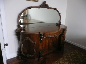 A mirror backed sideboard.