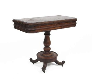 A Victorian fold over card table (150-250).