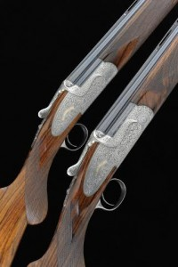 A pair of 20-bore Holland & Holland sporting model over and under ejector guns.