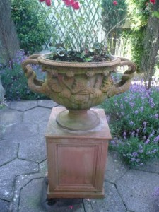 A terracotta urn and plinth.