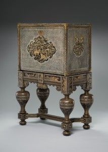 Cabinet on stand. Cabinet, Japan, 1600–1630; stand, Japan, incorporating elements from a Dutch table, 1625–1650. Oak and Chinese arborvitae covered in black lacquer, with gold and silver hiramaki-e, ray-skin denticles, mother-of-pearl, and gilt copper mounts. Peabody Essex Museum, Salem,