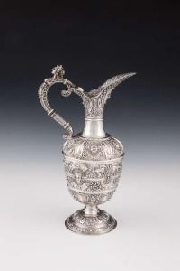 A VICTORIAN SILVER REPOUSSÉ CLARET JUG, London 1878 (2,000-3,000).