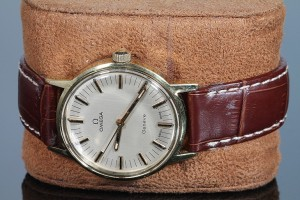 A vintage Omega wrist watch (200-300).