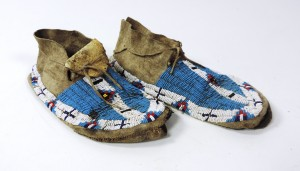 A pair of rare Plains beaded moccasins (1,000-1,500).