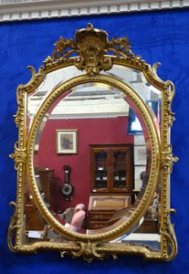 An Irish 19th century gilt wood over mantle mirror (2,500-3,500).