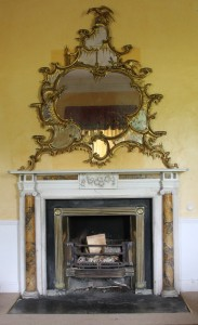 An 18th century carved gilt wood mirror originally at Carton (30,000-50,000).