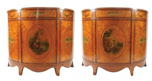 A pair of 19th century satinwood and painted commodes  (10,000-15,000)
