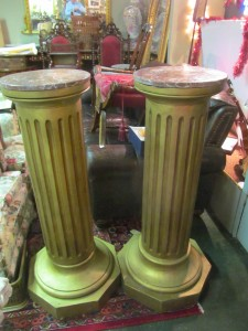 A pair of carved gilt wood pedestals (400-700).