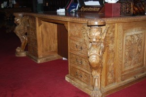 The heavily carved late 19th century walnut reception desk.