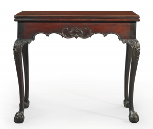 FROM THE ZAITZ COLLECTION: THE DESHLER FAMILY CHIPPENDALE CARVED MAHOGANY CARD TABLE, PROBABLY THE SHOP OF BENJAMIN RANDOLPH (1737-1791/2); THE CARVING ATTRIBUTED TO JOHN POLLARD (1740-1787), PHILADELPHIA, CIRCA 1769-1770 $300,000-500,000).