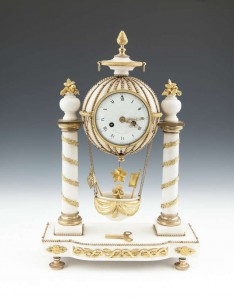 A FRENCH MARBLE AND ORMOLU MOUNTED 'BALLOON' MANTLE CLOCK (2,000-3,000).
