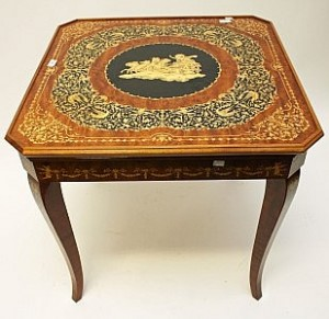 An unusual marquetry games table (200-400)