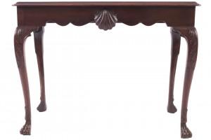 An Irish 18th century mahogany console table (4,000-6,000).