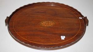 A Georgian mahogany oval tray (100-150)