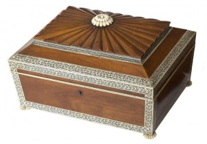 An Anglo-Indian sandalwood and ivory workbox (1,000-1,500).