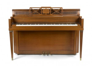 LADY GAGA'S FIRST CHILDHOOD PIANO ($100,000-200,000)