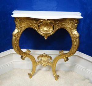 A gilt console table.