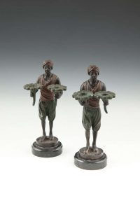 FRANZ BERGMAN (AUSTRIAN, 19TH CENTURY) A pair of cold painted bronzes depicting standing blackamoor figures Signed and dated 'F. Bergman, 1882' (400-600)
