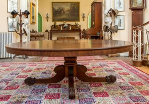 A circular William IV dining table