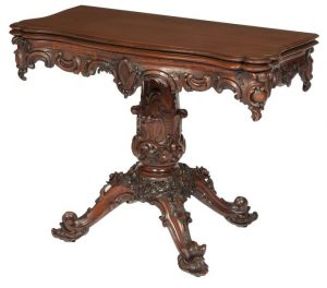 An Irish exhibition carved yew wood centre table by Arthur Jones Dublin (12,000-18,000)