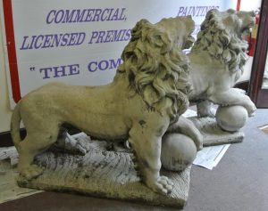 A pair of stone lions on plinths.