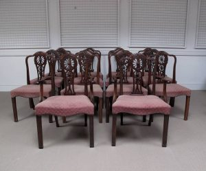 A set of 14 early 19th century Hepplewhite style dining chairs (7,000-8,000)