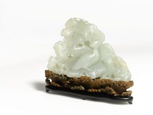 A Qing Dynasty Qianlong white jade  Mandarin Ducks and Rockwork group
