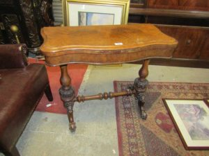 A walnut games table (250-350).