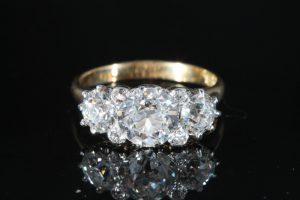 A three stone diamond ring (20,000-22,000)
