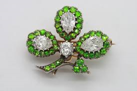 A shamrock brooch.