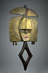 A powerfully abstract mbulu ngulu reliquary figure of the Kota people, Gabon, West Africa.  Kota mbulu ngulu are unique among African sculptural forms in their combination of wood covered with hammered metal, in this instance copper.  (£11,500 from David Malik)