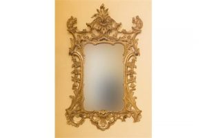 18TH CENTURY CARVED IRISH GILTWOOD WALL MIRROR, the rococo crest with C-scrolls (8,000-12,000)