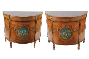 Pair of 19th century satinwood and painted and parcel gilt commodes (14,000-18,000)