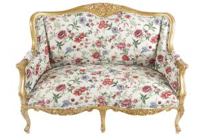 One of a pair of carved gilt wood Louis XV style settees (1,500-2,500)