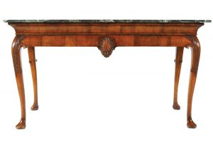 One of a pair of Irish Walnut console tables (6,000-8,000)